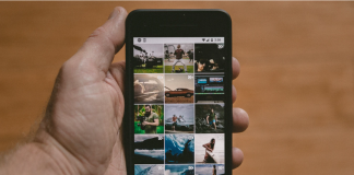 man holding phone with instagram feed