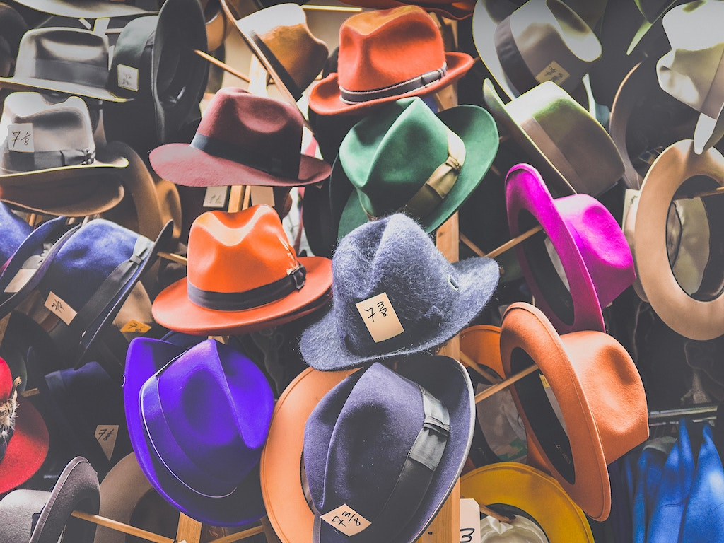 Colorful Fedora hats hanging on the hats rack