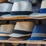 Different hat brands on line up on the rack for sale