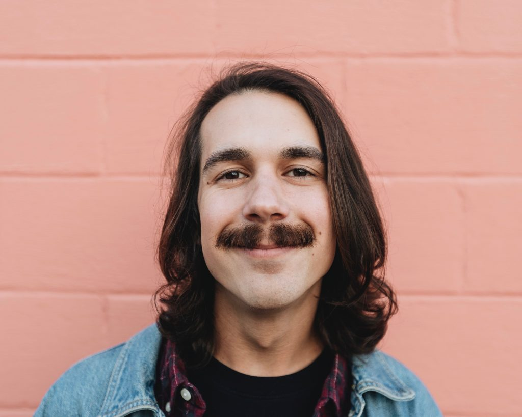 man with a mustache smiling