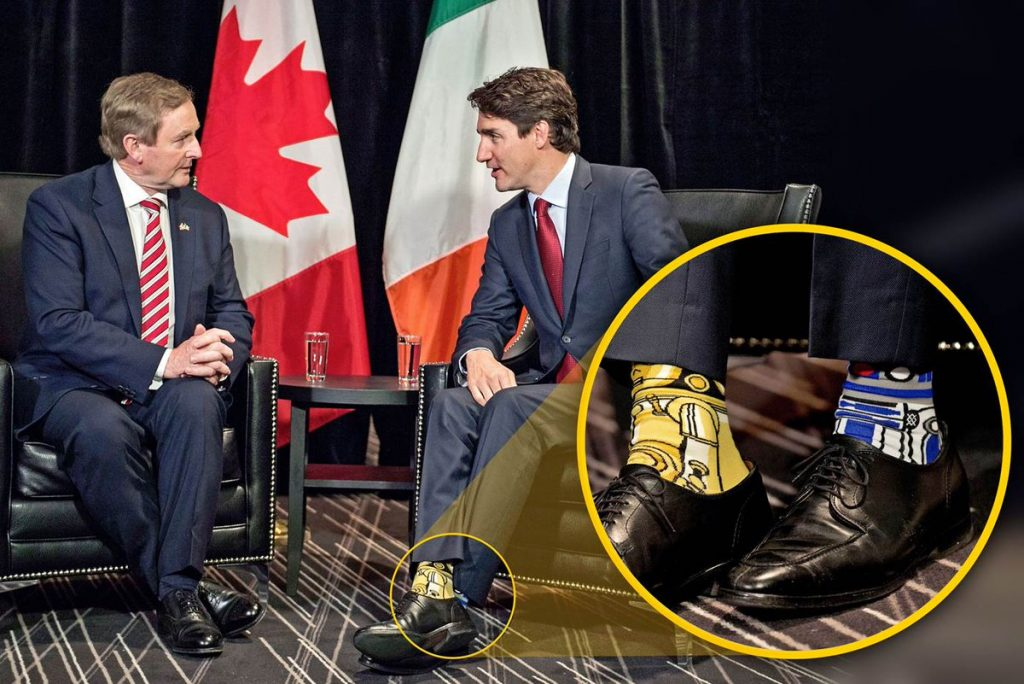 Justin Trudeau and former Irish PM Enda Kenny, focus shot on Trudeau's socks