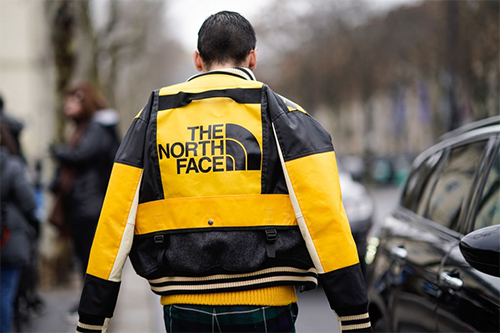 The North Face limited edition yellow black leather jacket during Paris fashion show