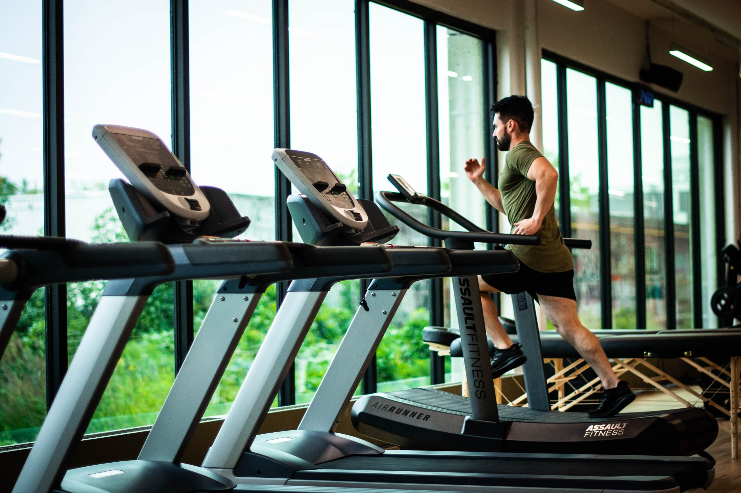man running on a treadmill in the gym