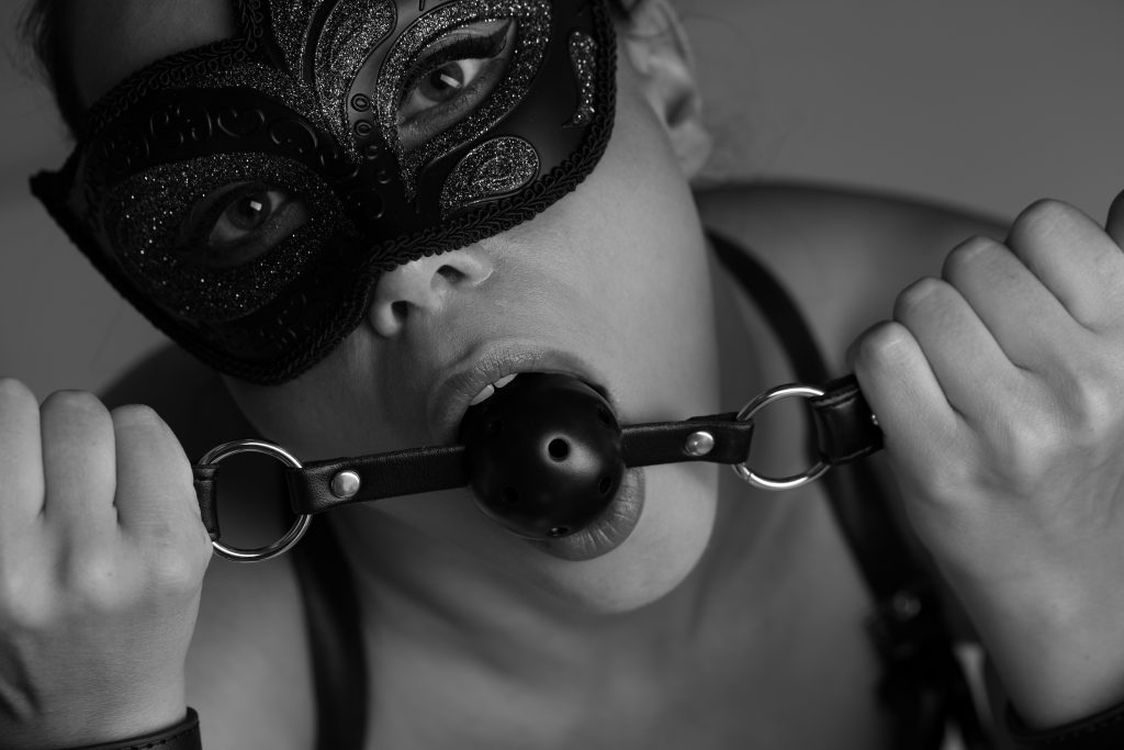 Sexy woman with mask and ball gag