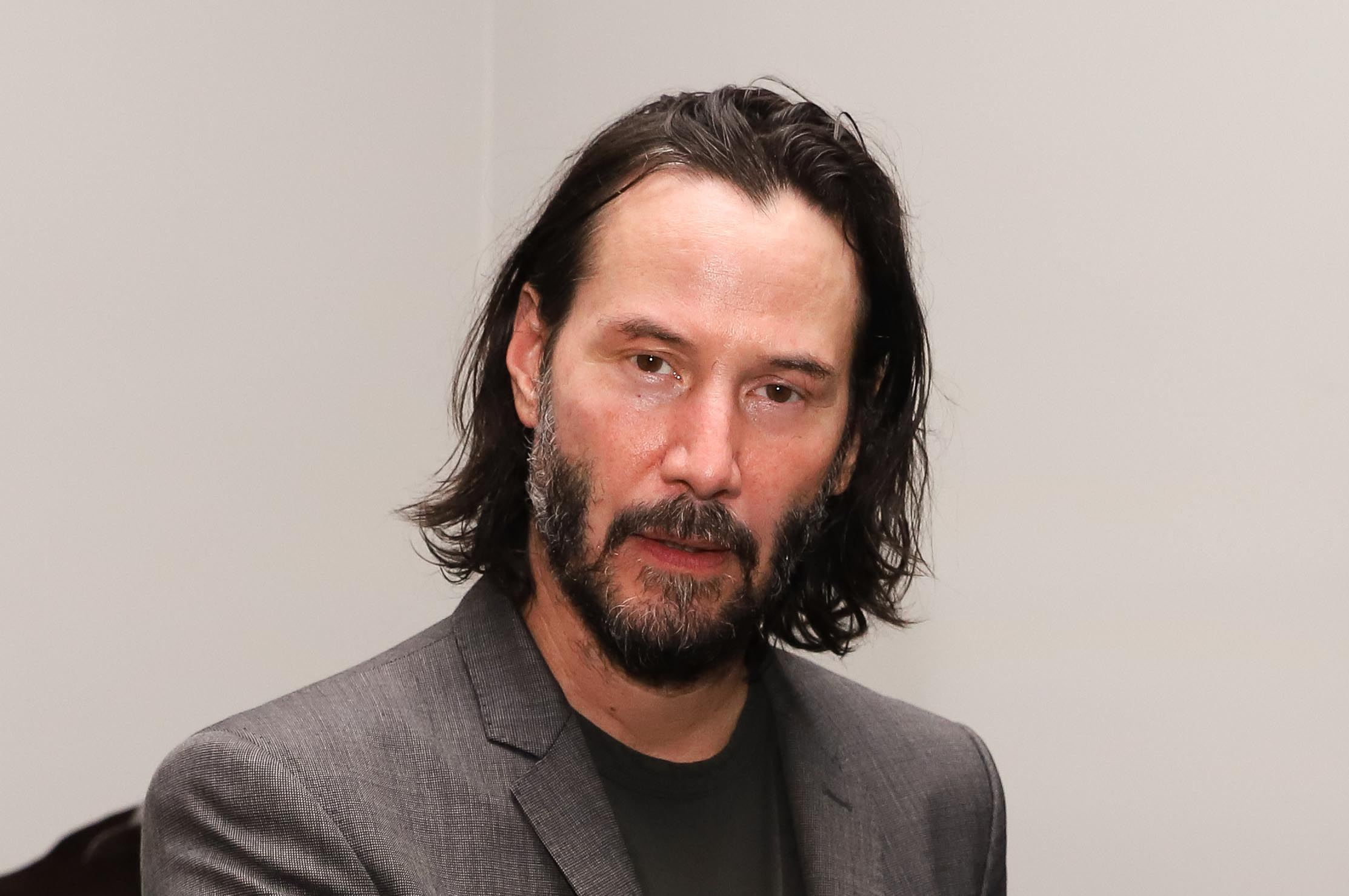 Keanu Reeves and his signature bro flow hair.