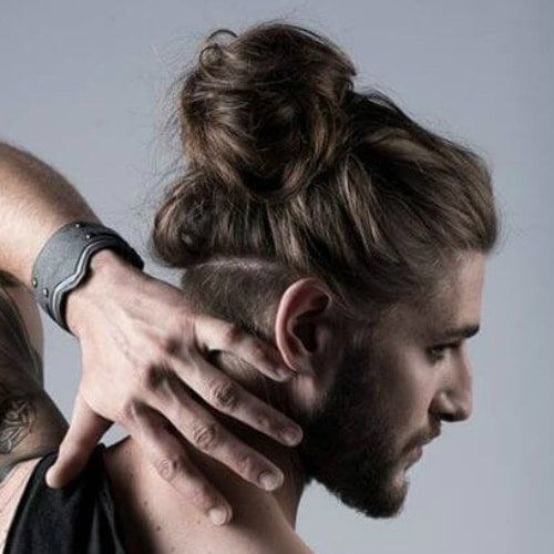 back view of a man showing off his undercut with hooked top hairstyle