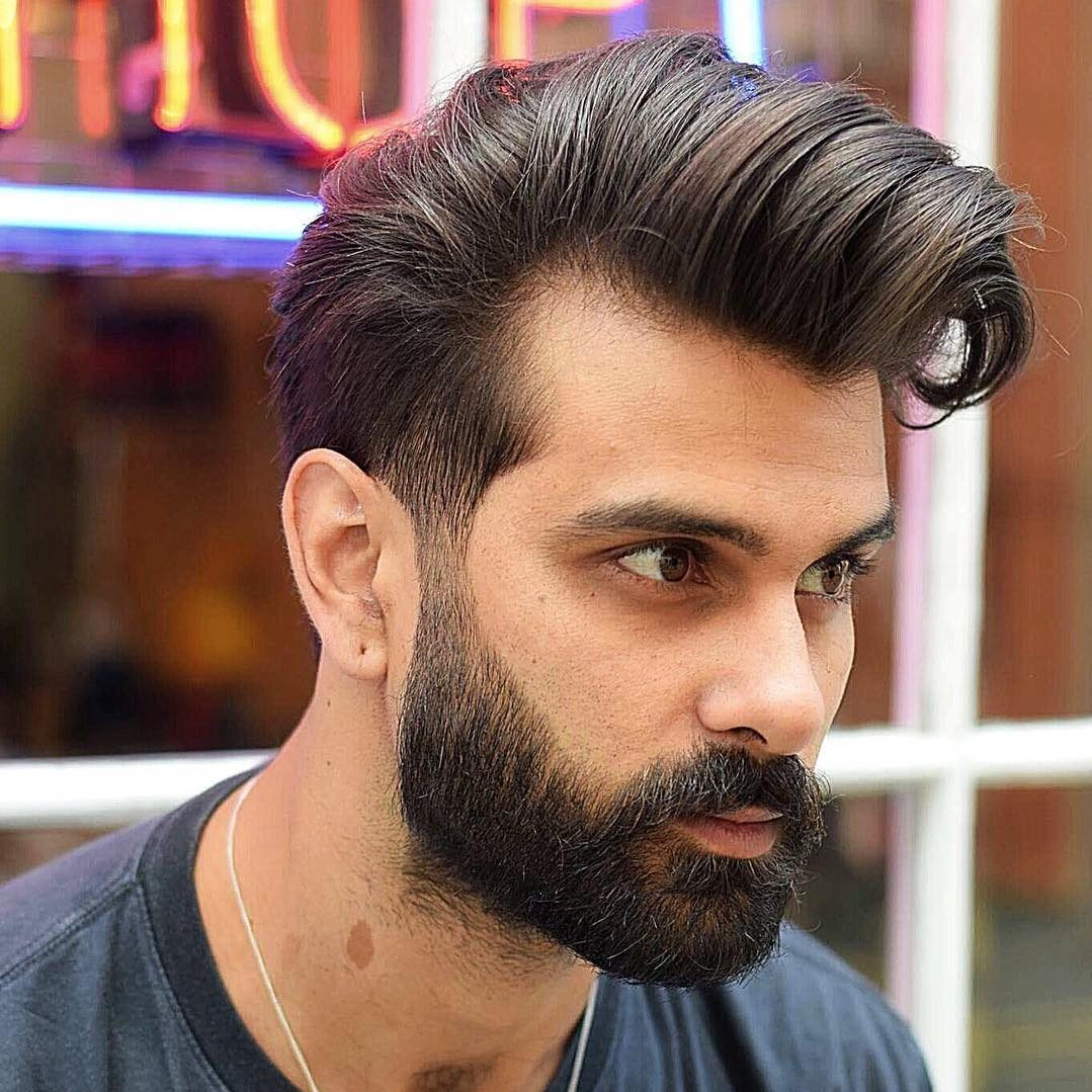 bearded man with a rolled comb-over