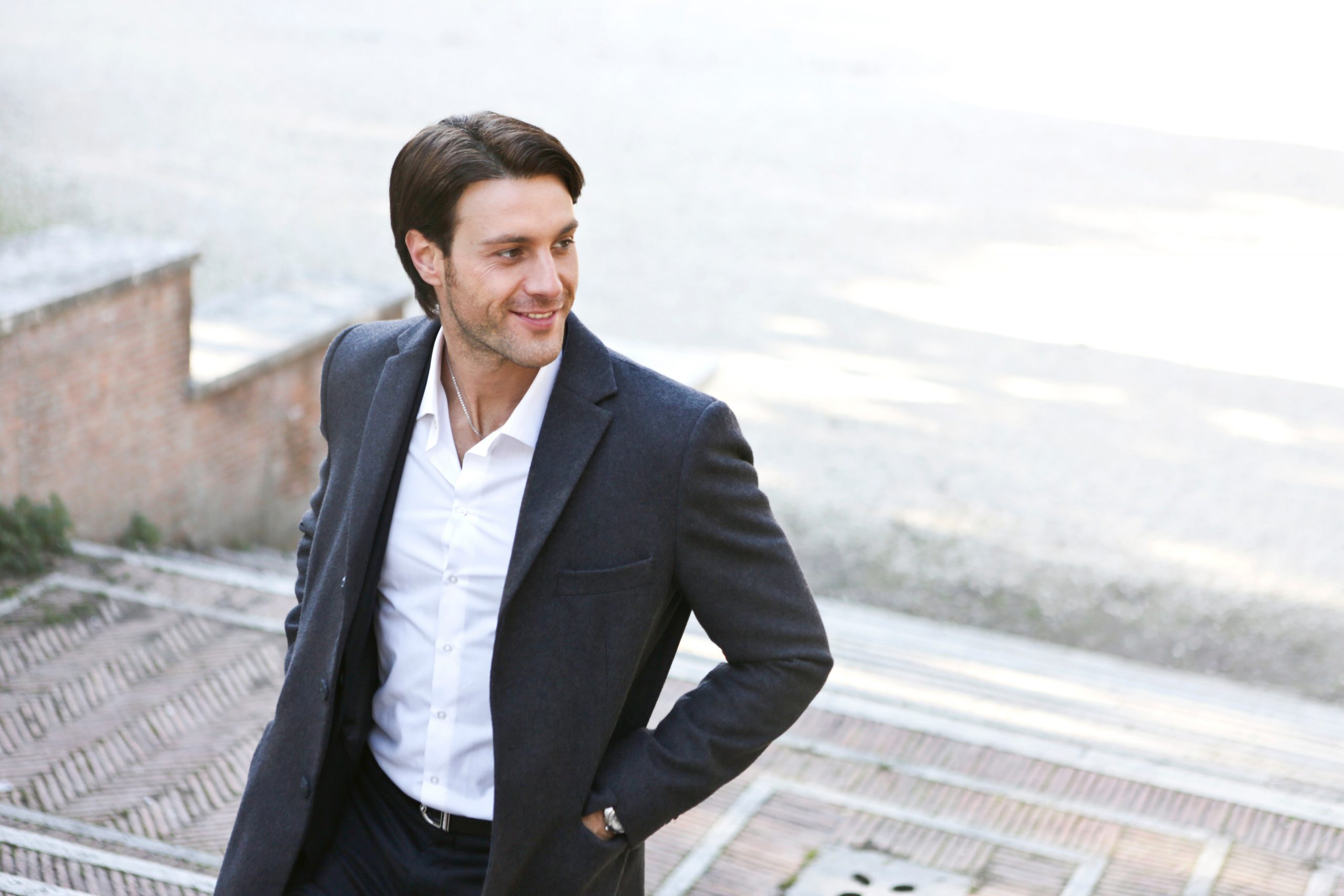 man walking up the stairs wearing a black blazer and white dress shirt, business casual for men