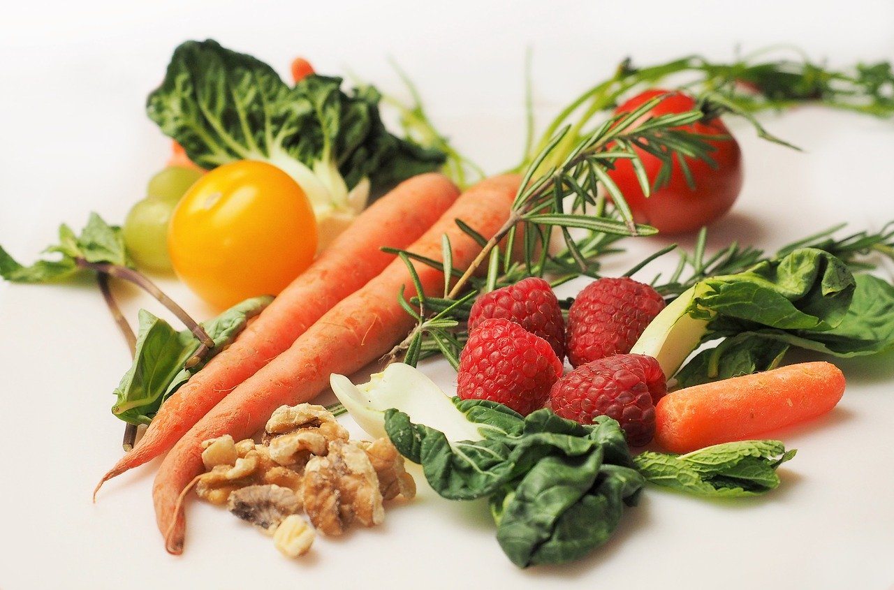leafy vegetables, carrots, tomatoes, rosemary, walnuts and raspberries