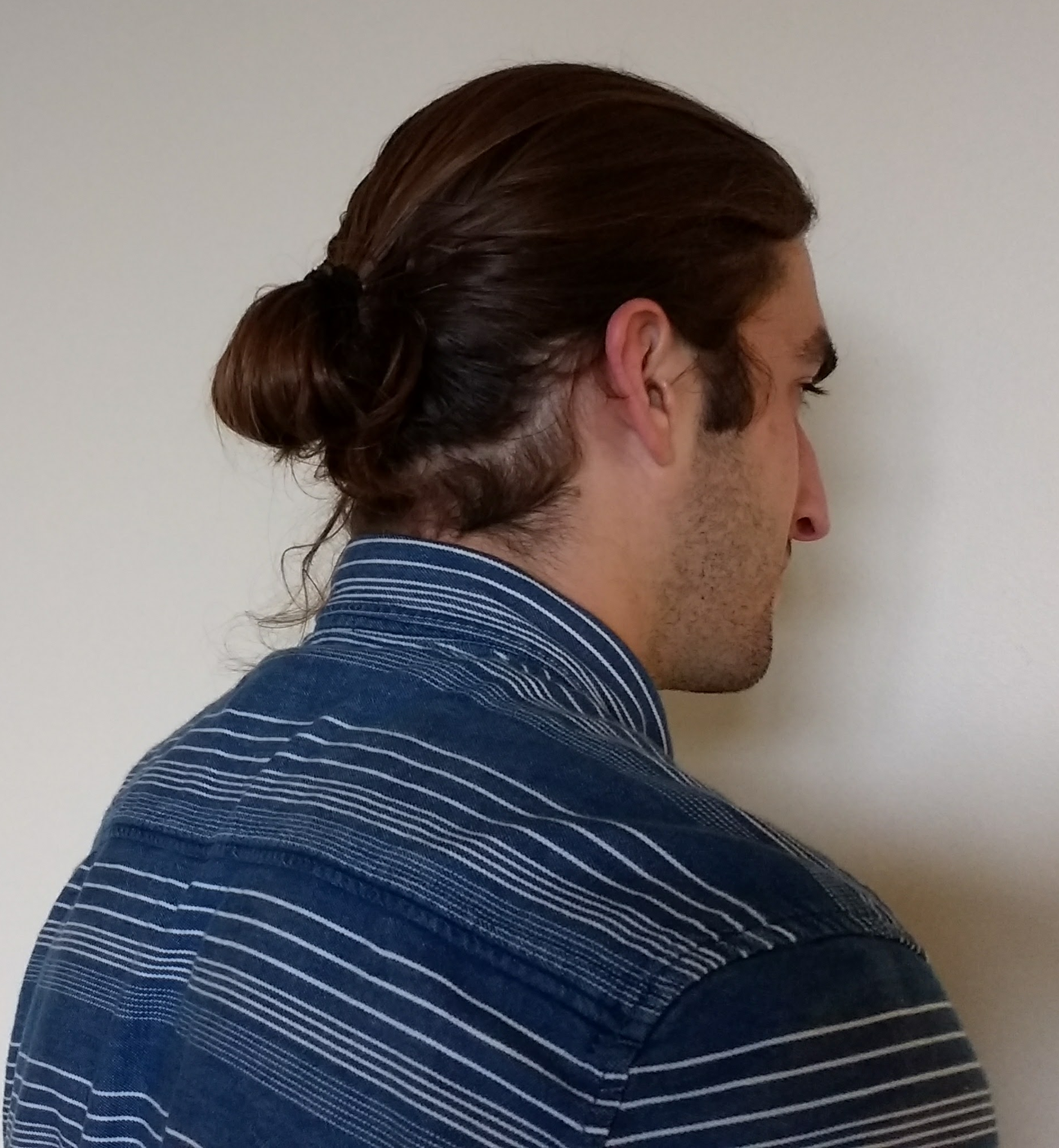 The man bun is an easy solution to getting all that hair out of the way.