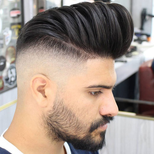 man with a high pomp and high faded sides