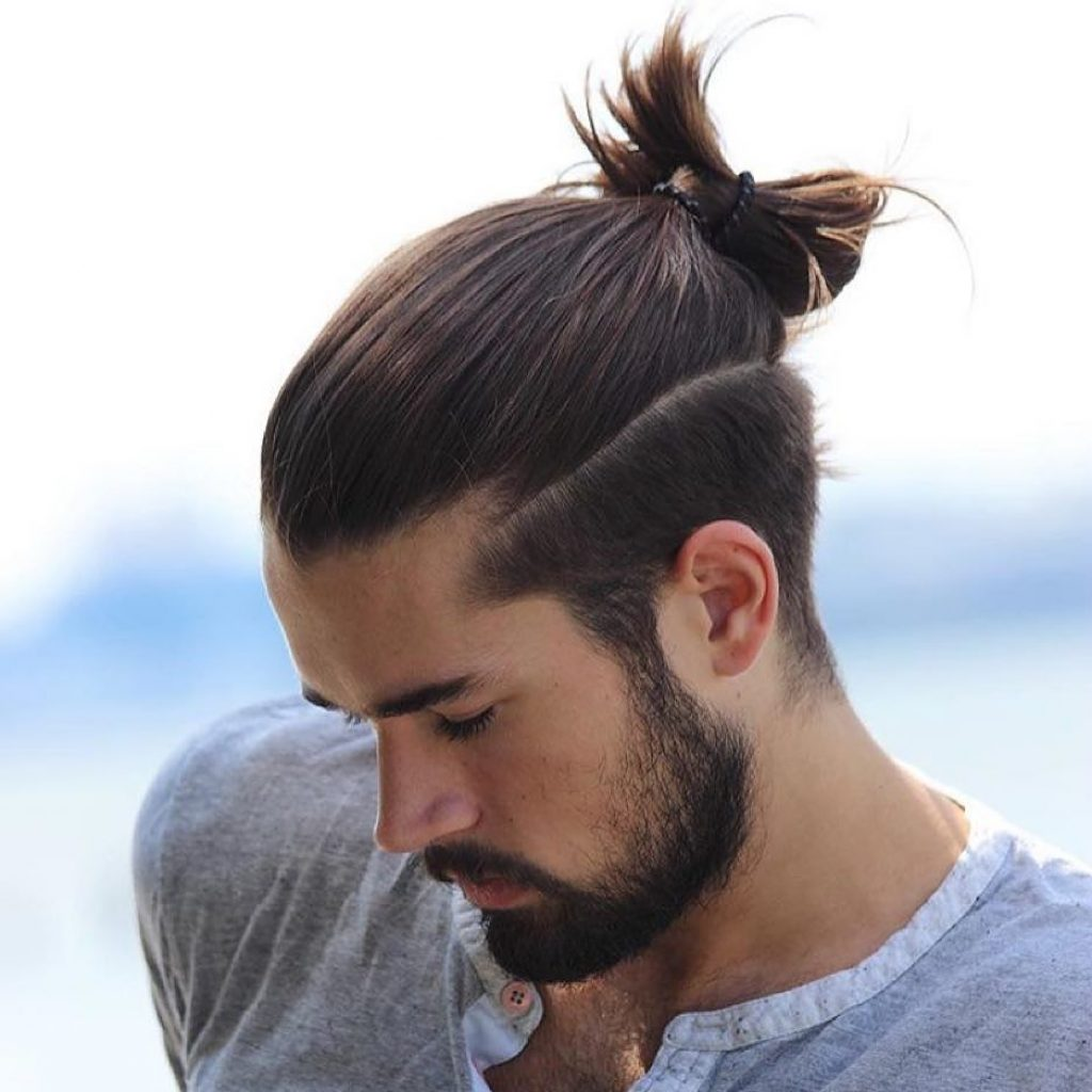 man with a top knot