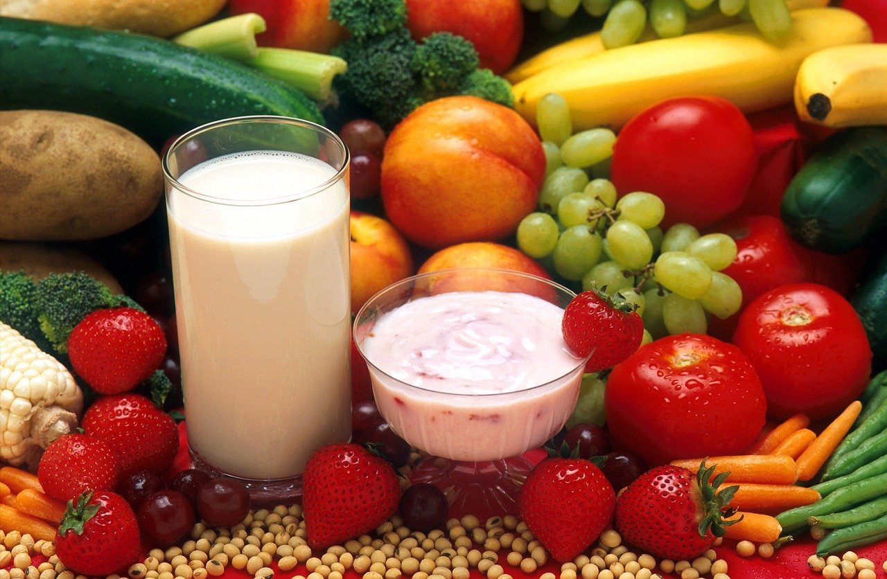 a spread of fruits, vegetables, dairy and beans