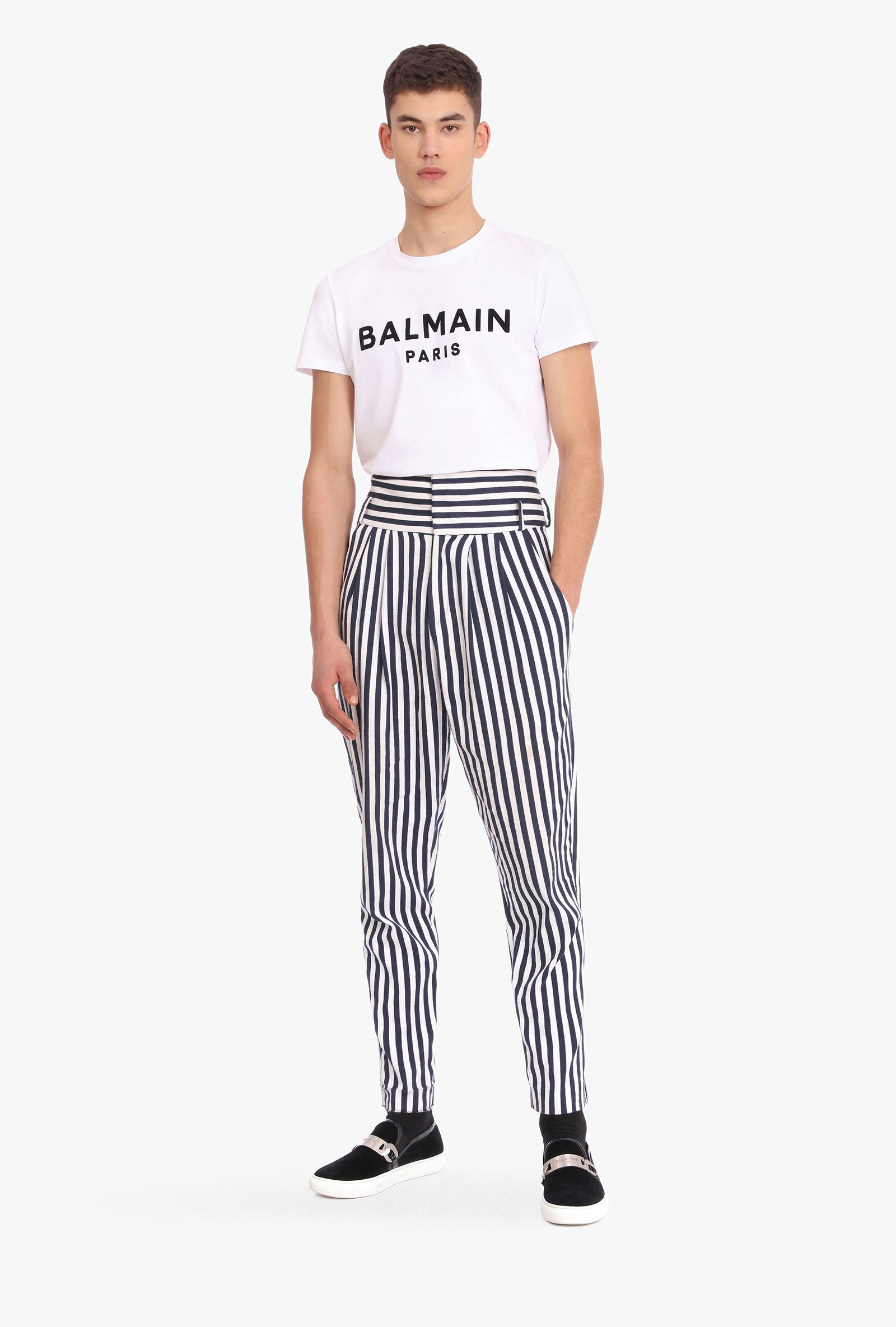 man wearing a Balmain shirt and high waisted striped pants, casual fashion, casual outfits, casual clothes, casual wear