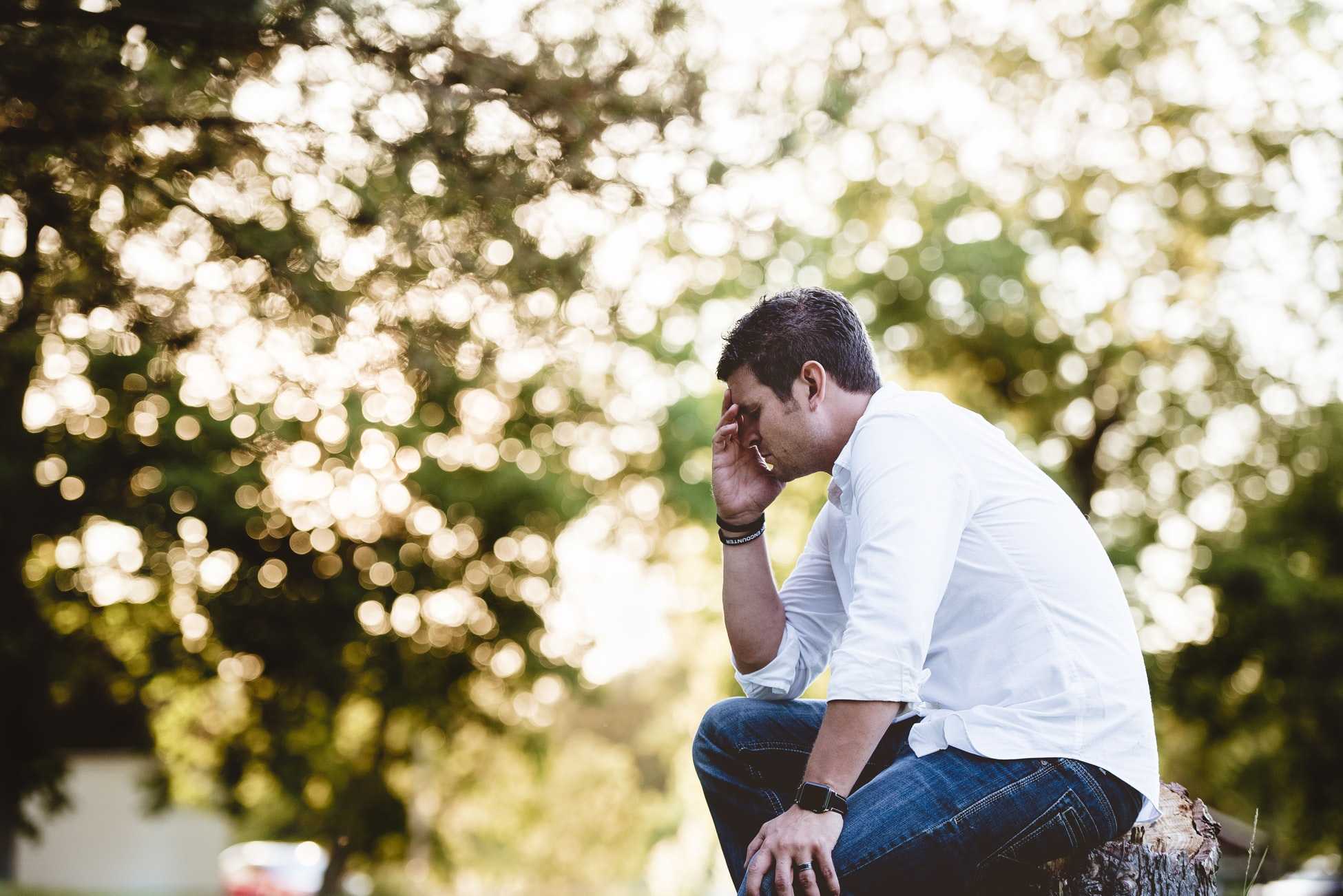 man in a white shirt and jeans looking stressed, moving on, dealing with a breakup