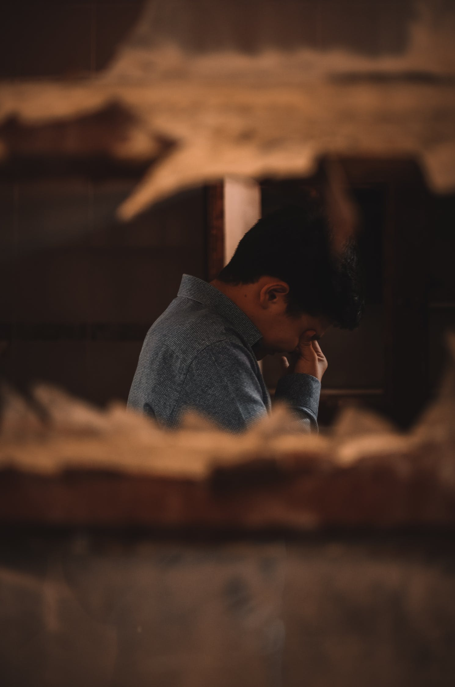 focus shot of a man looking distressed, grieving, crying, moving on, healing process