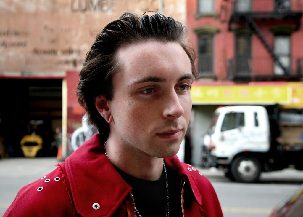 slicked-back hairstyle, men's hairstyles for thinning hair
