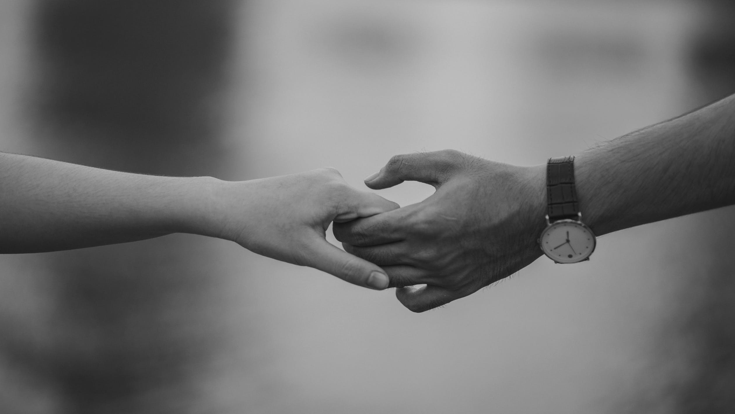 black and white picture of a couple holding hands