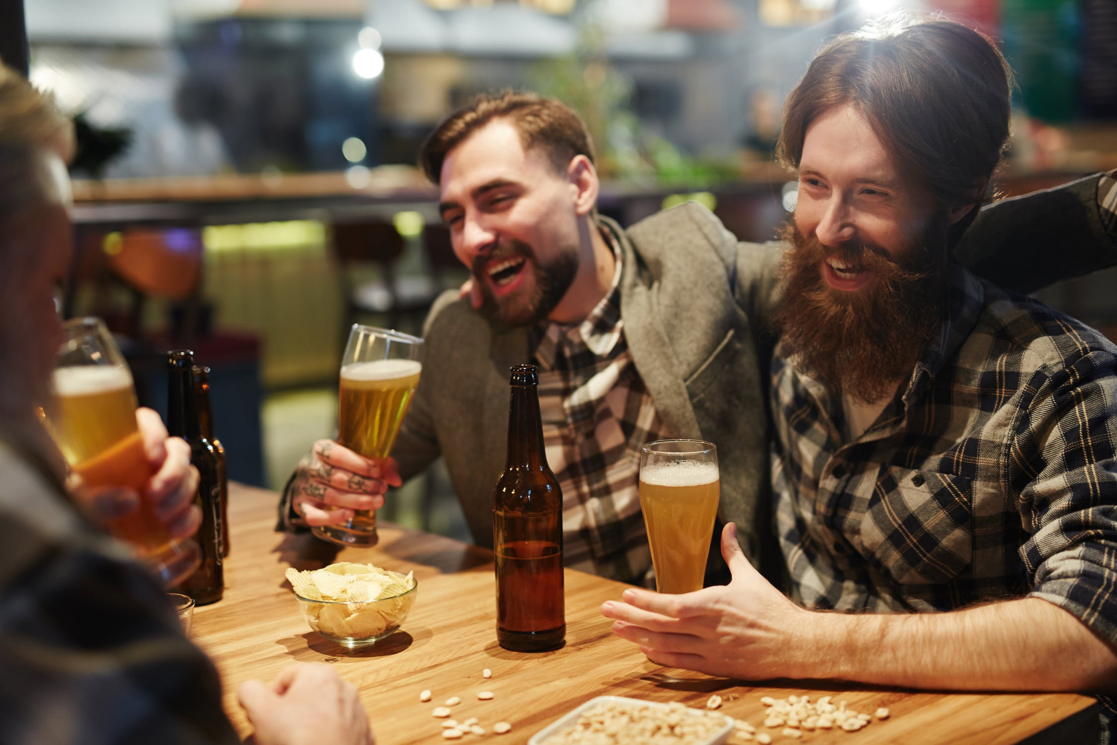 group of bearded men drinking beer and laughing, friends, moving on, good company