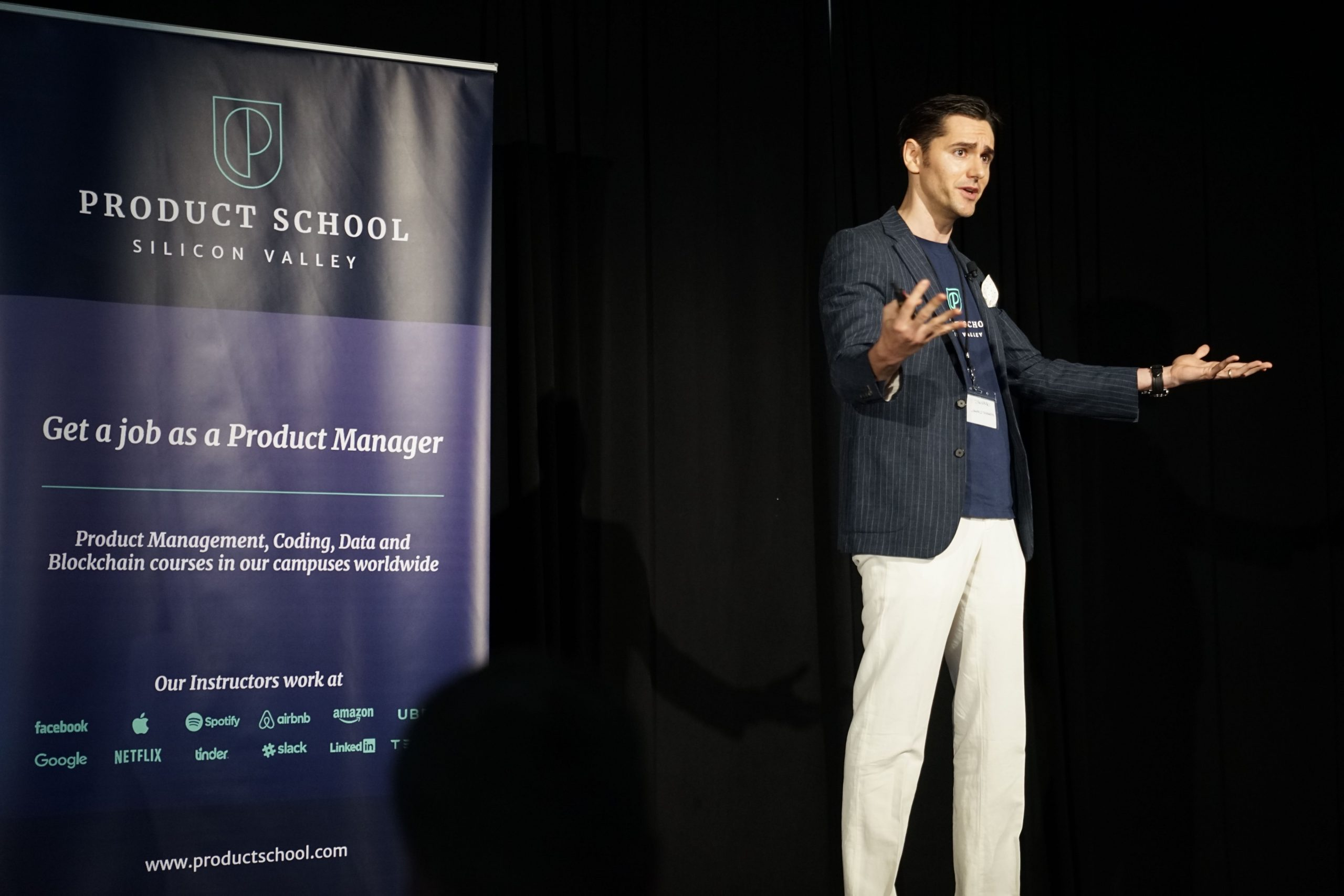 Man giving a talk at an event or conference