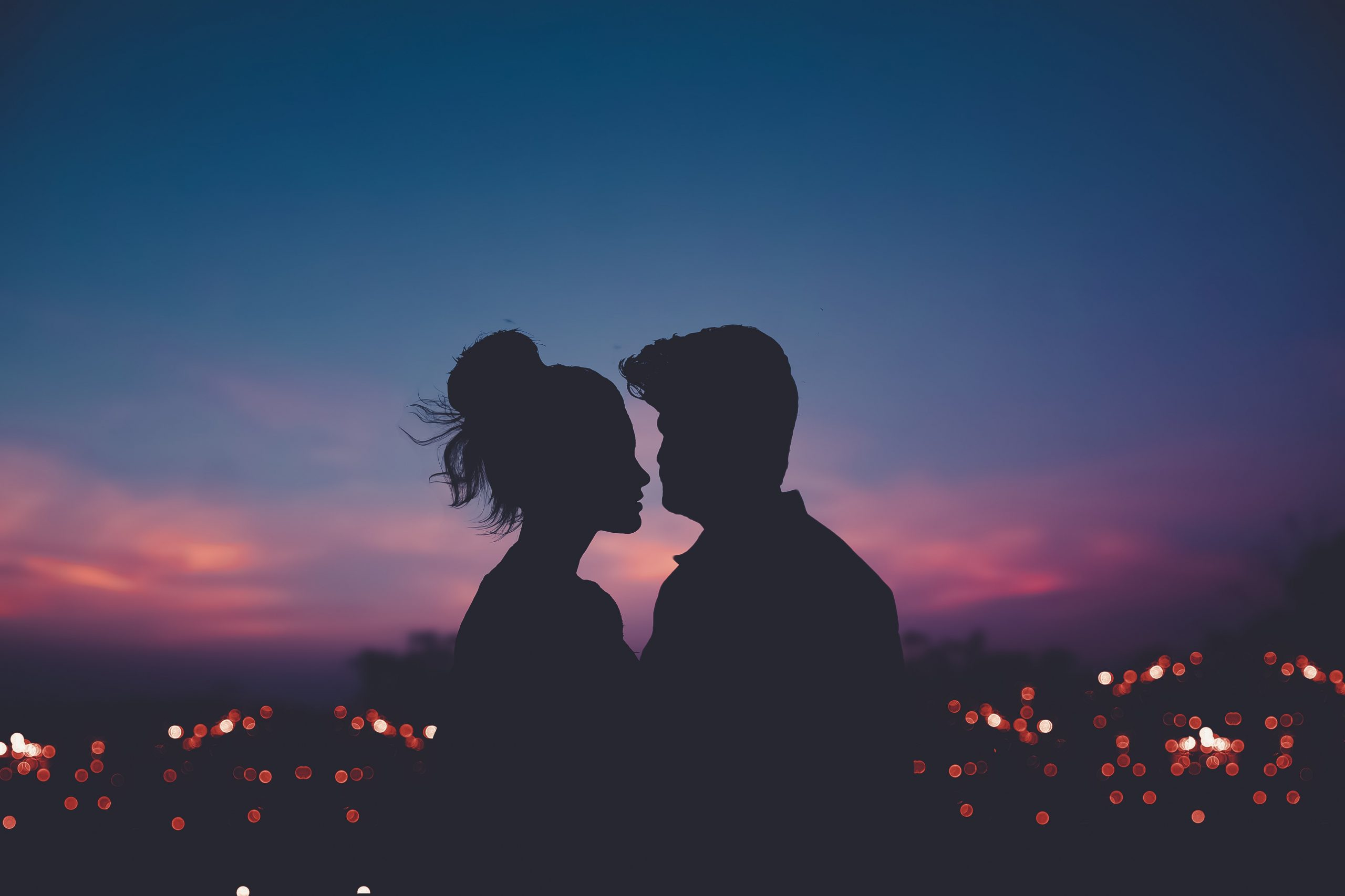 silhouette of a couple against the evening sky