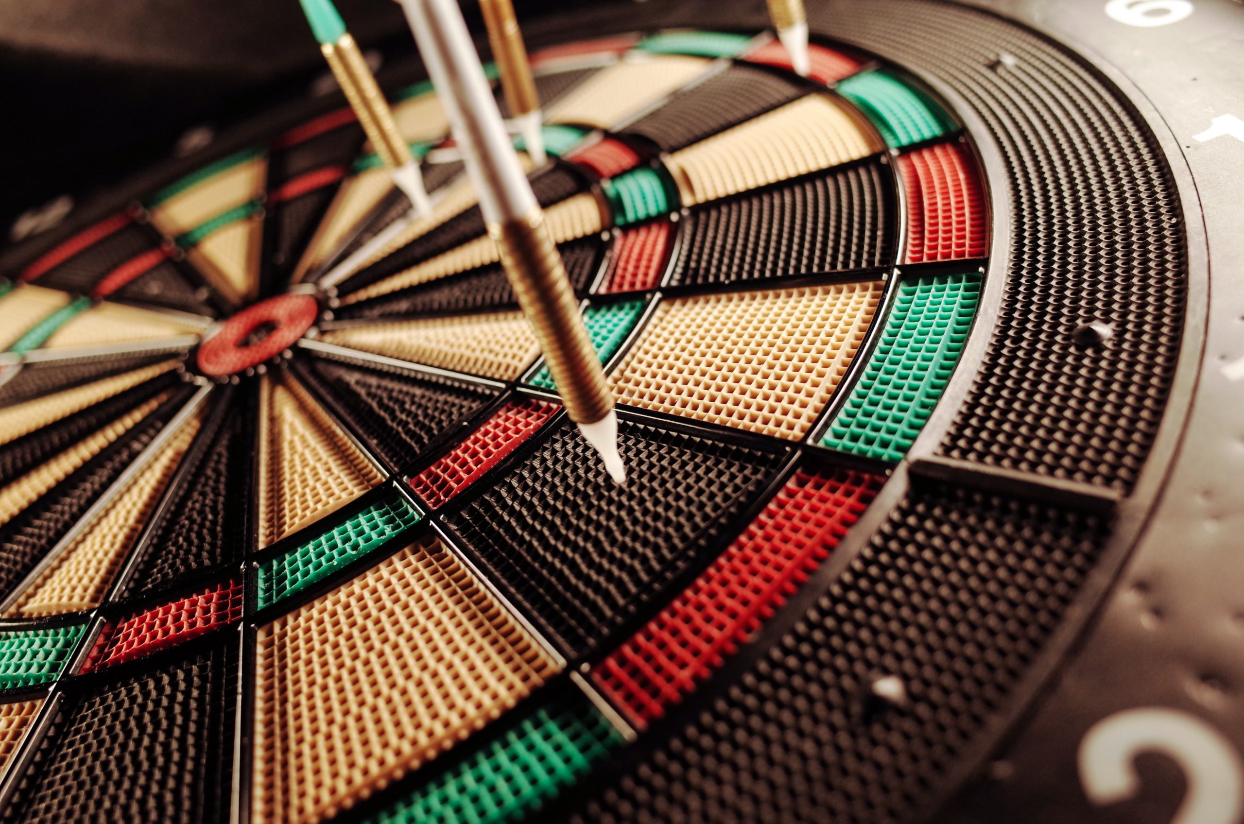 close-up of darts on a rubber target board