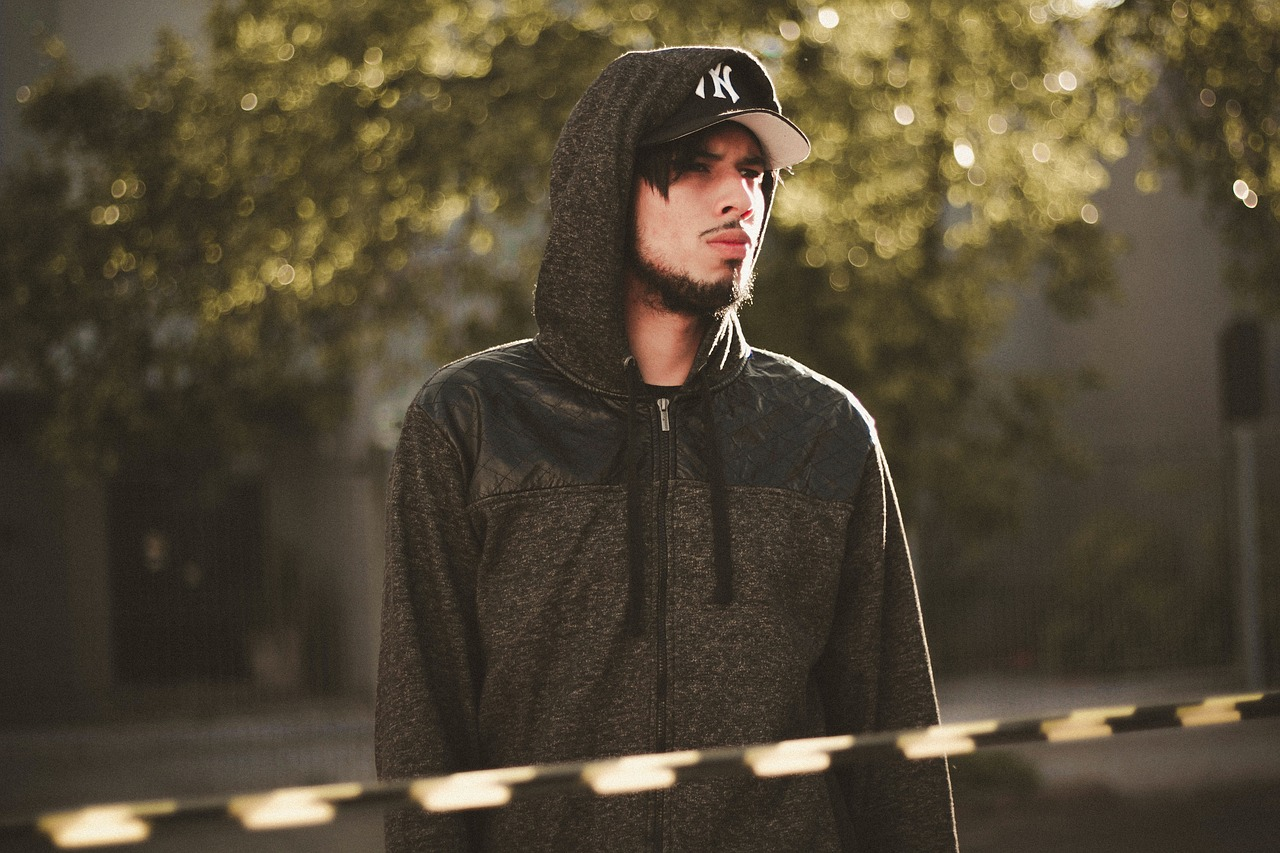 man wearing a black hoodie and cap, athleisure basics