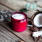 white cream in a red container with a coconut husk, argan seed and lavender, natural hair conditioner, hair care, organic