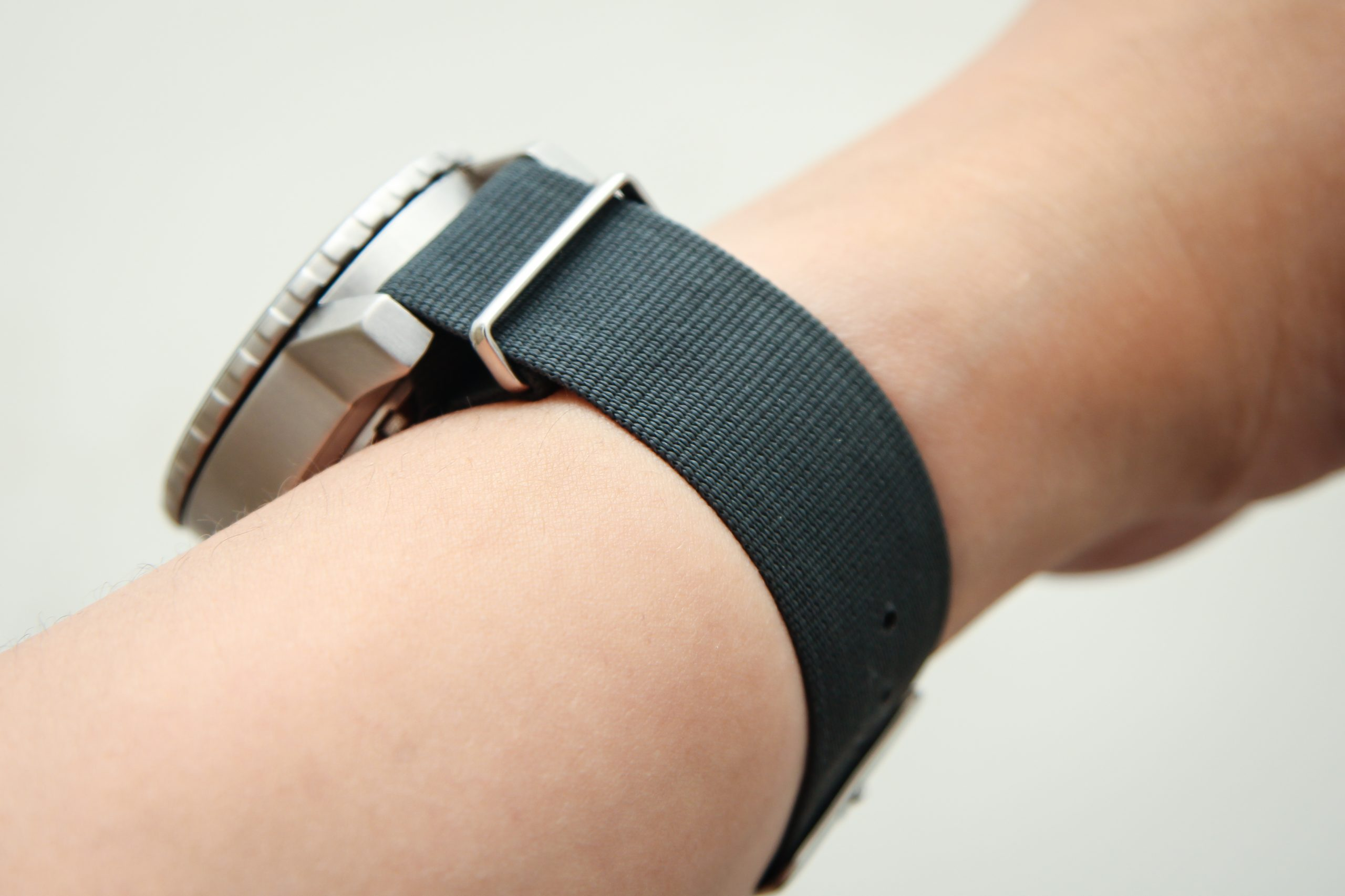 fabric watch strap on a person's wrist