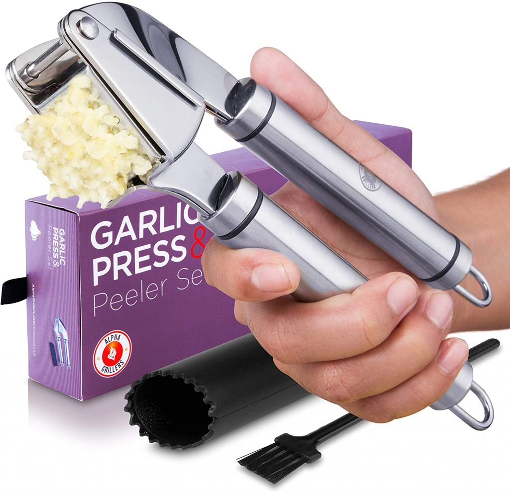 Garlic press with the peeler tube and oil brush