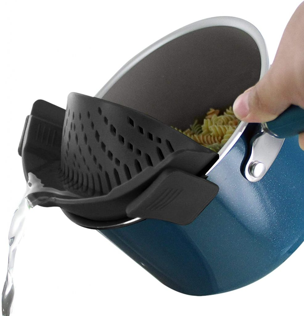 Black pasta strainer clipped on a blue pot
