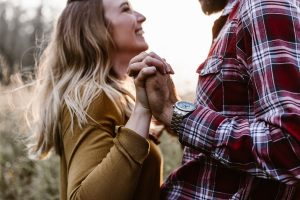man and woman holding hands, dating advice for men