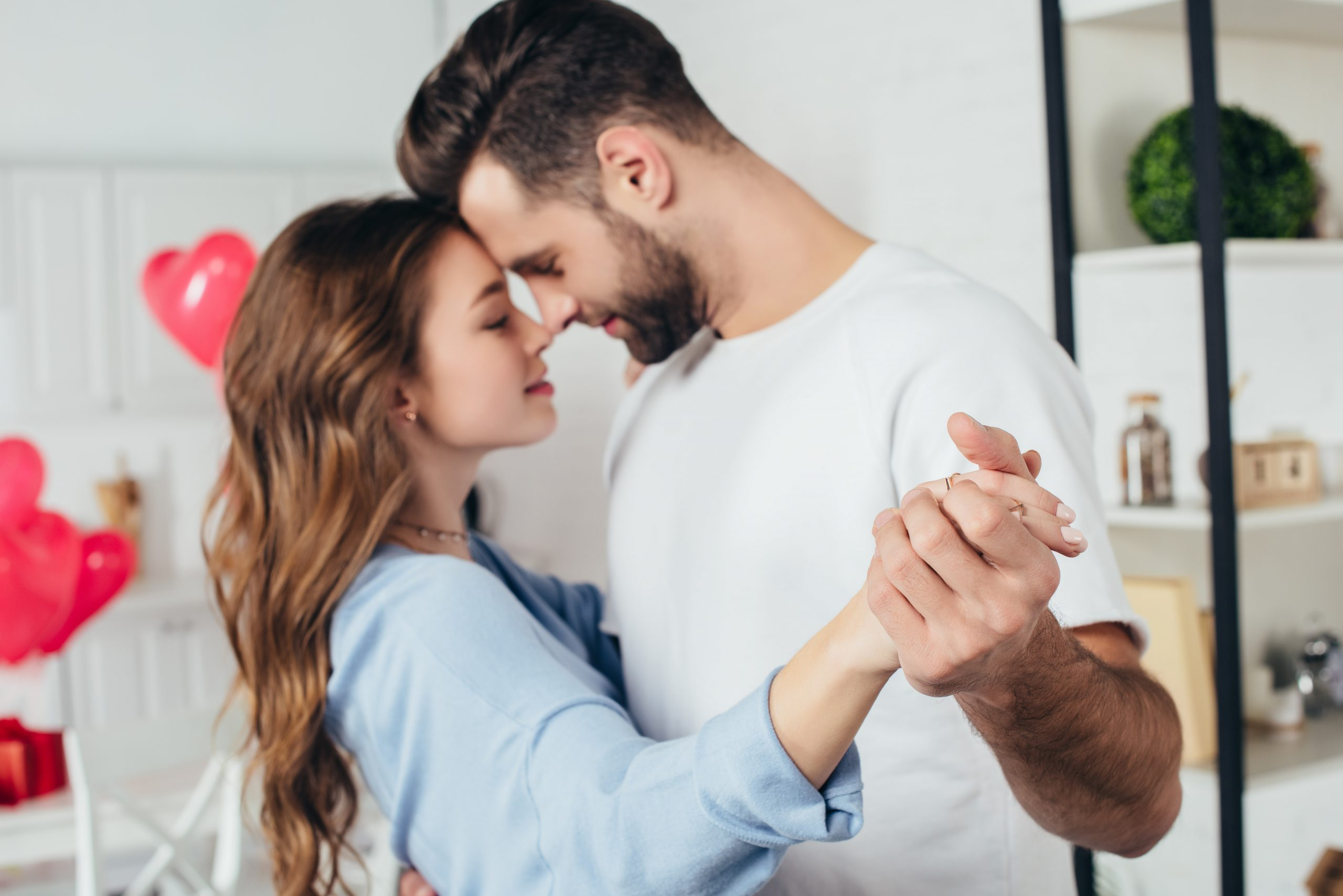 couple slow dancing together at home
