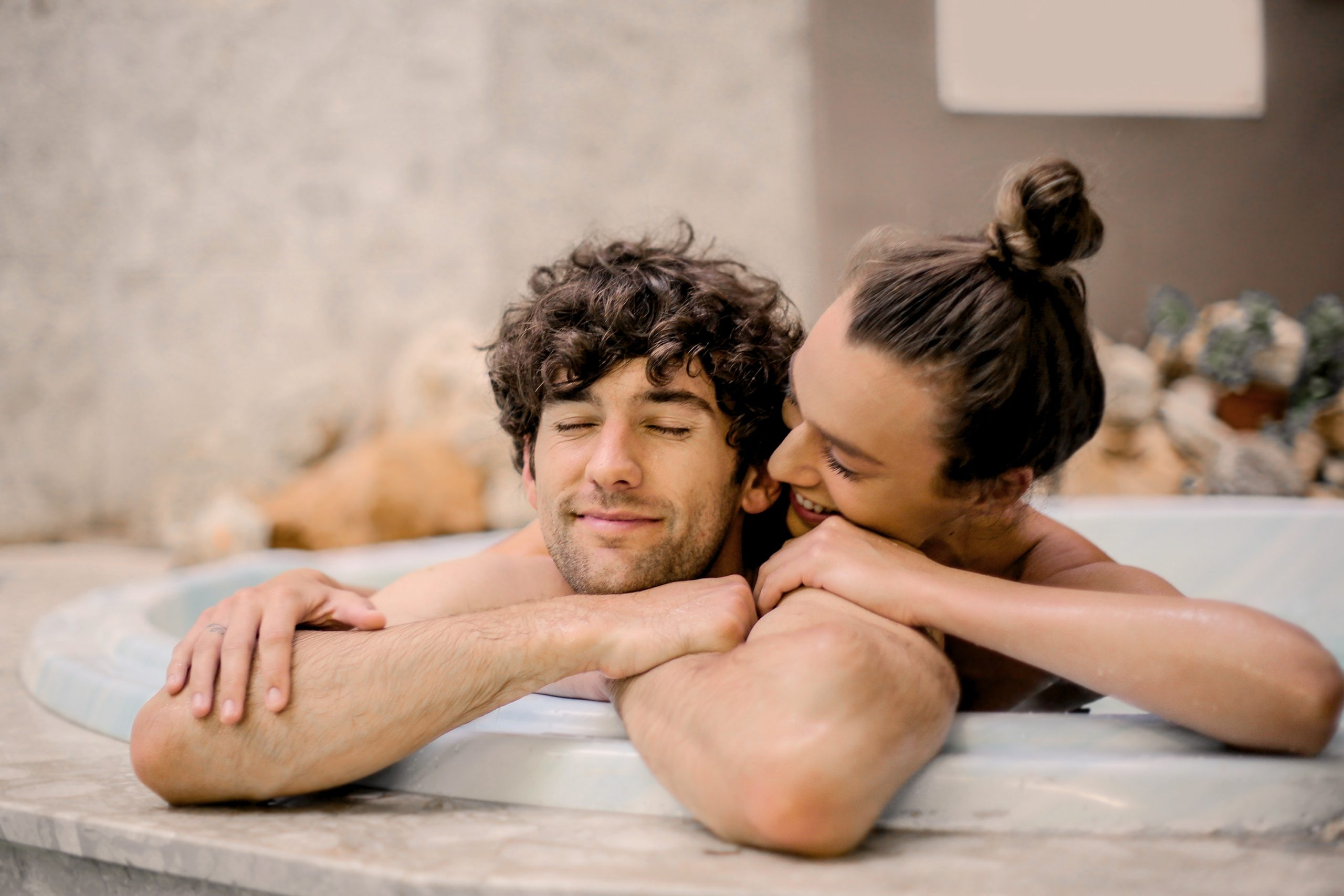 couple embracing in a jacuzzi tub together