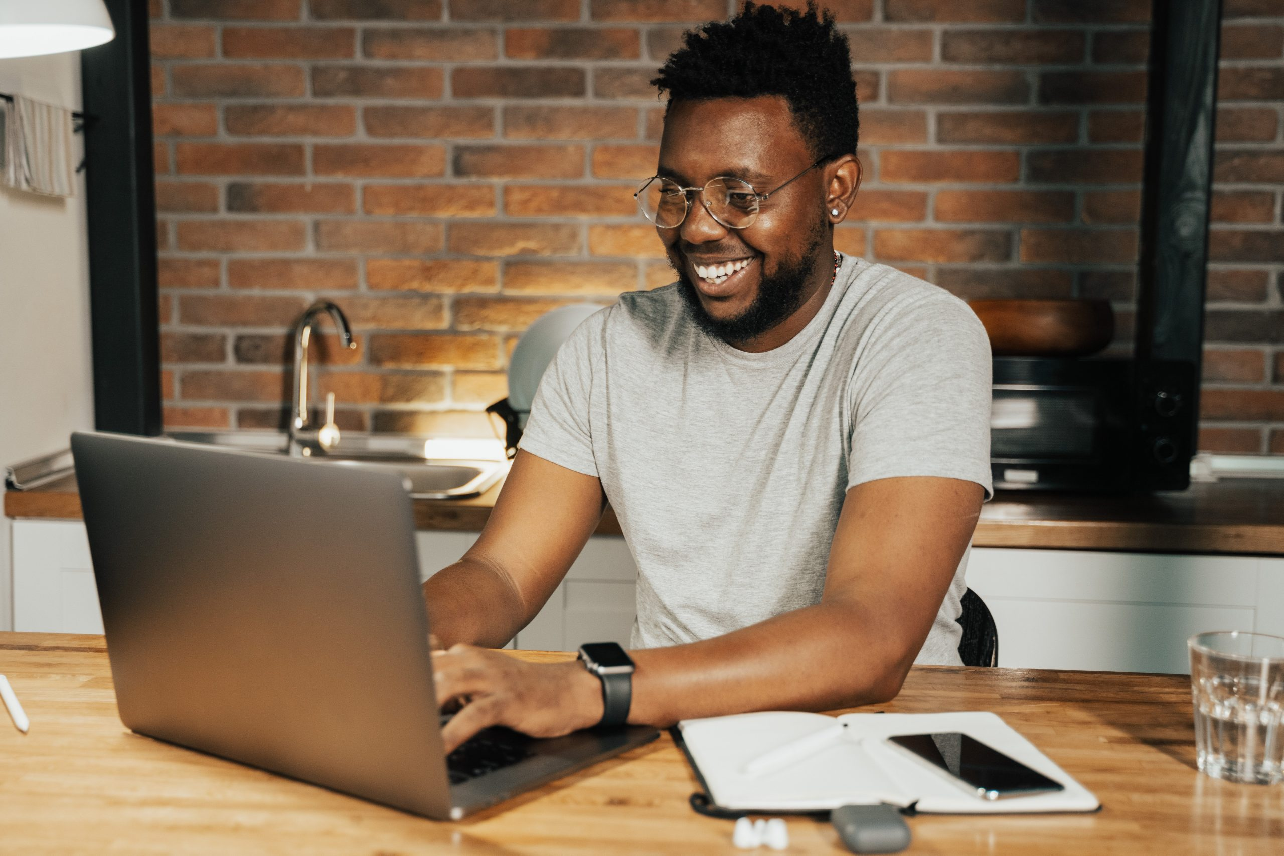 man working on laptop after an afternoon nap