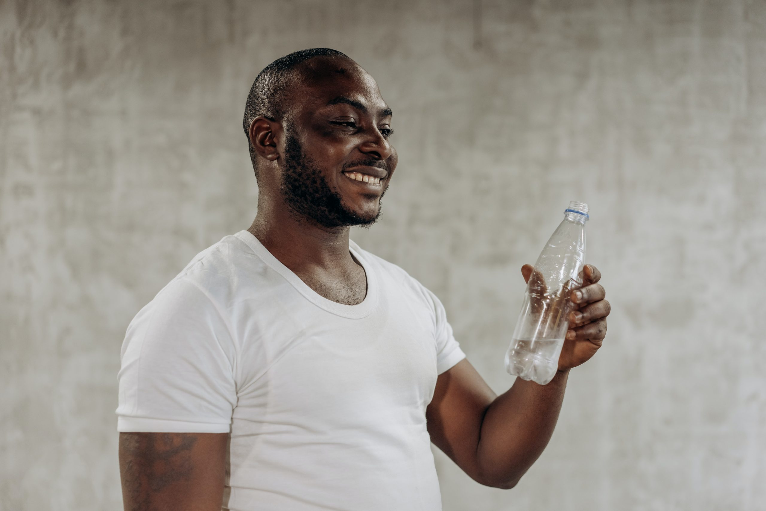 man drinking water after he napped