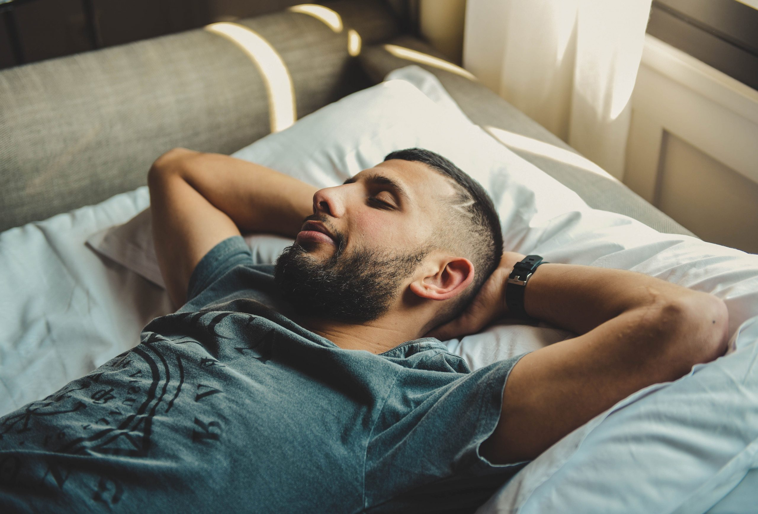 man having a power nap in bed