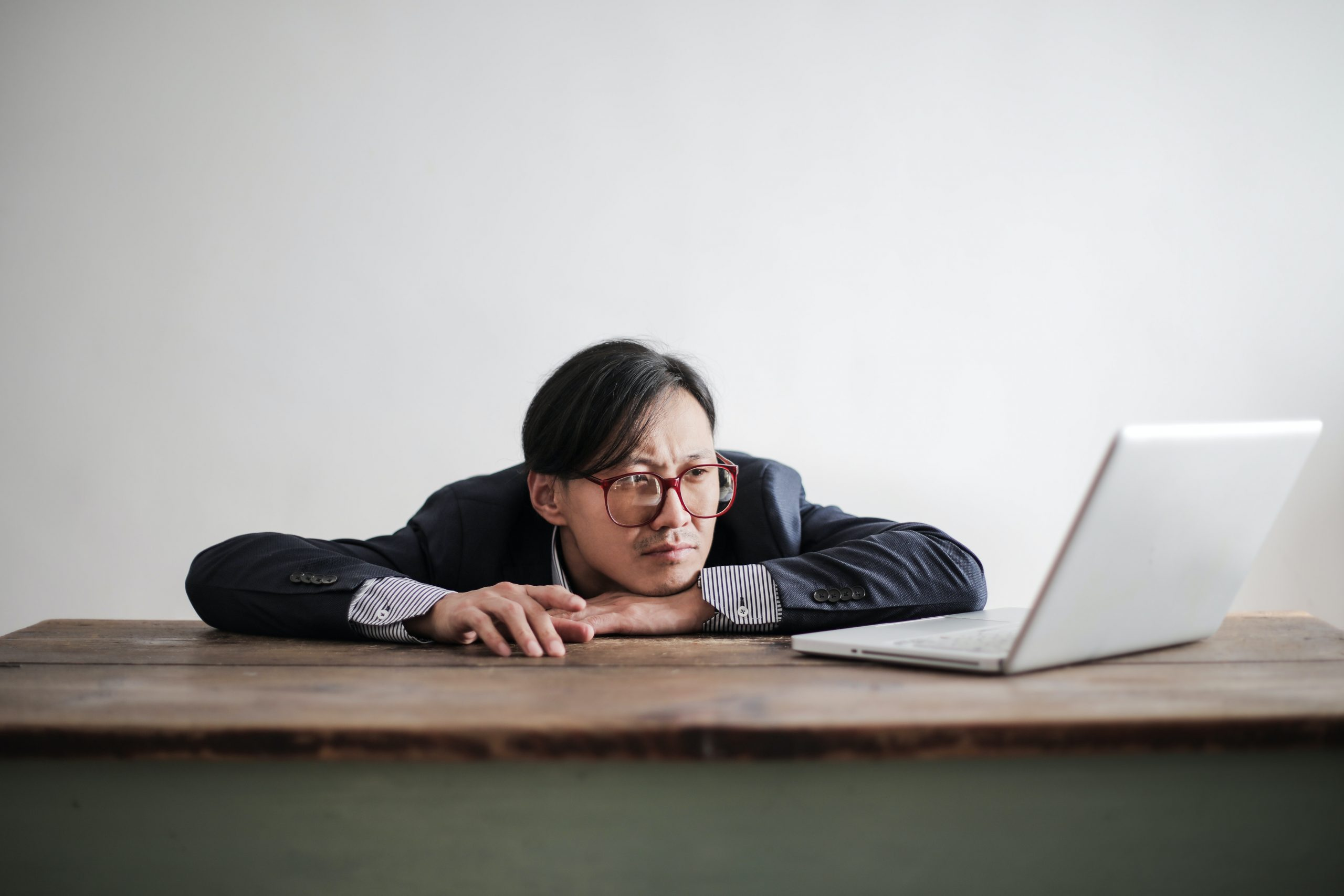 man experiencing counterproductivity as he works