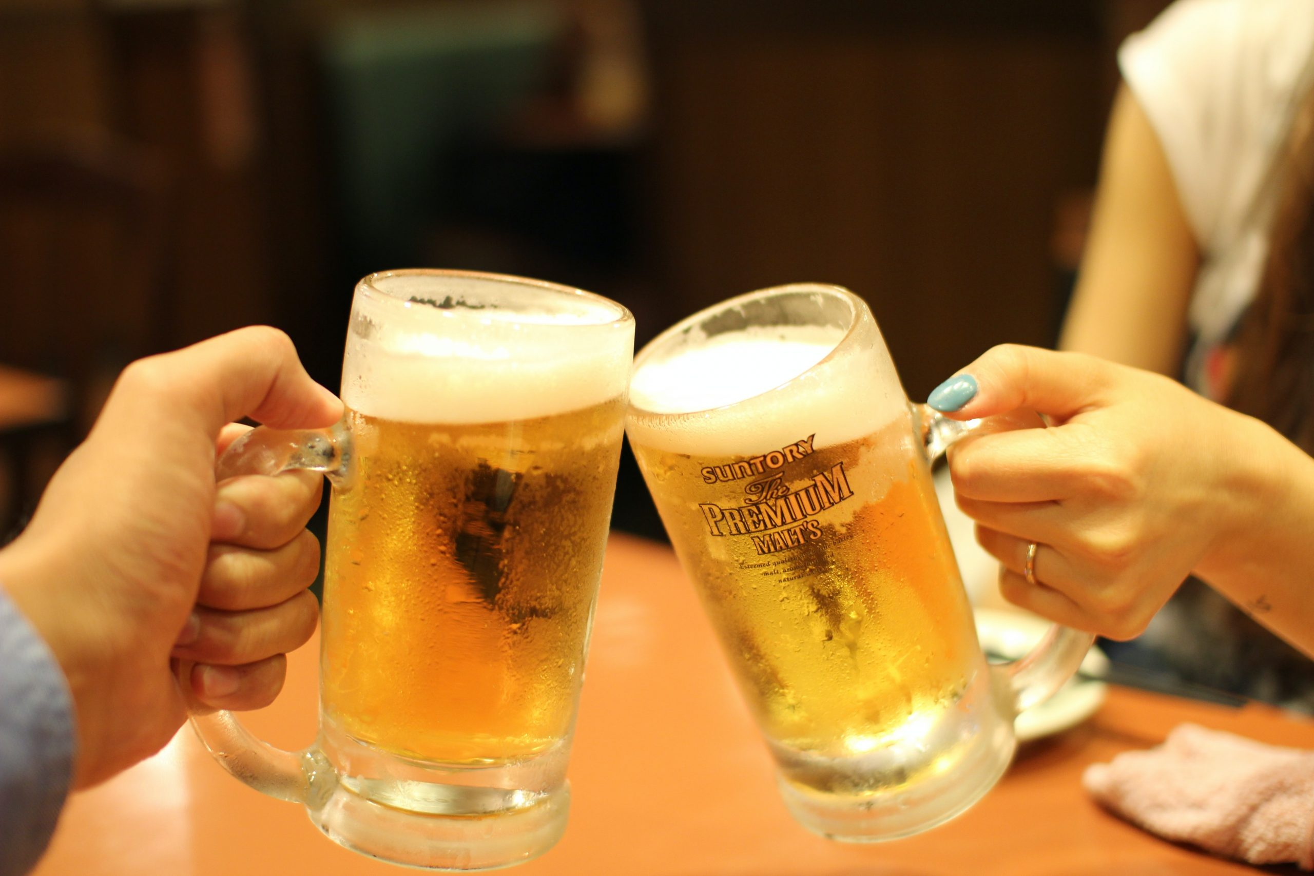 toasting two mugs of beer