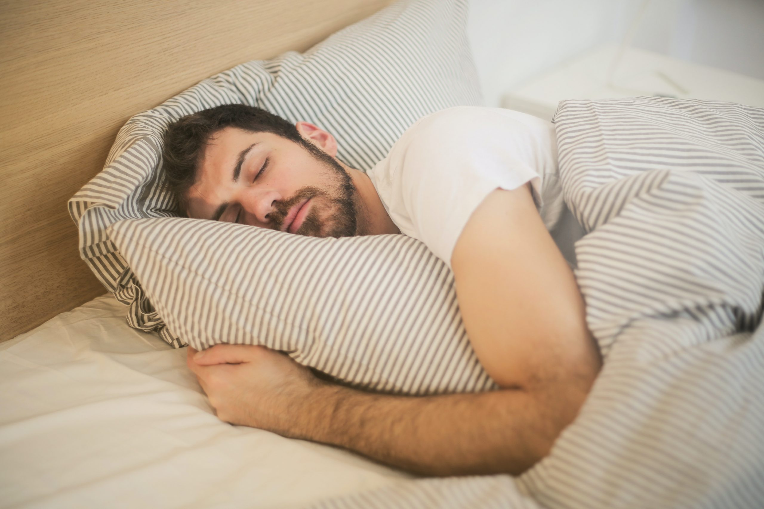 man sleeping as a way on how to get rid of man boobs at home