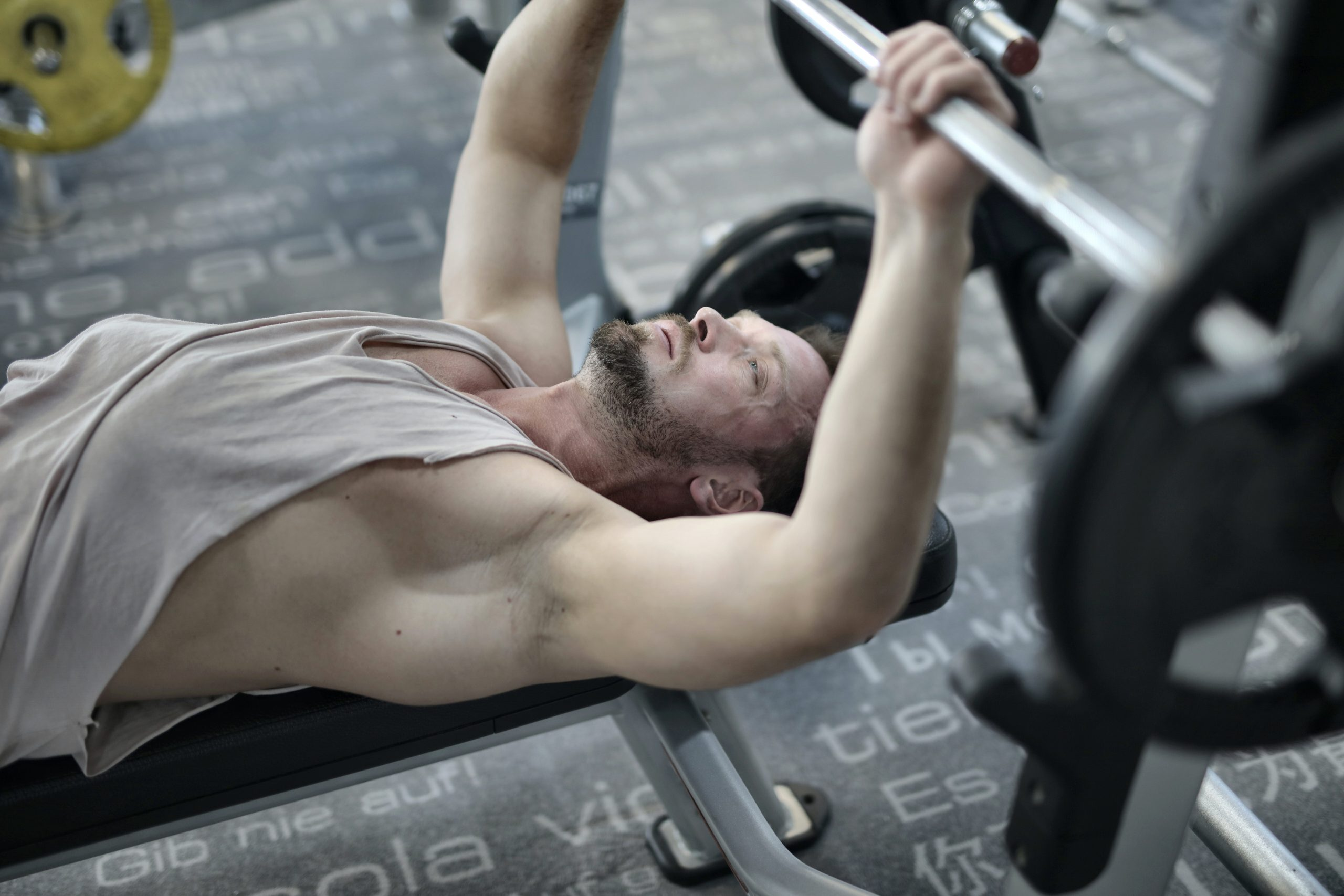 strong man showing how to get rid of man boobs with a workout