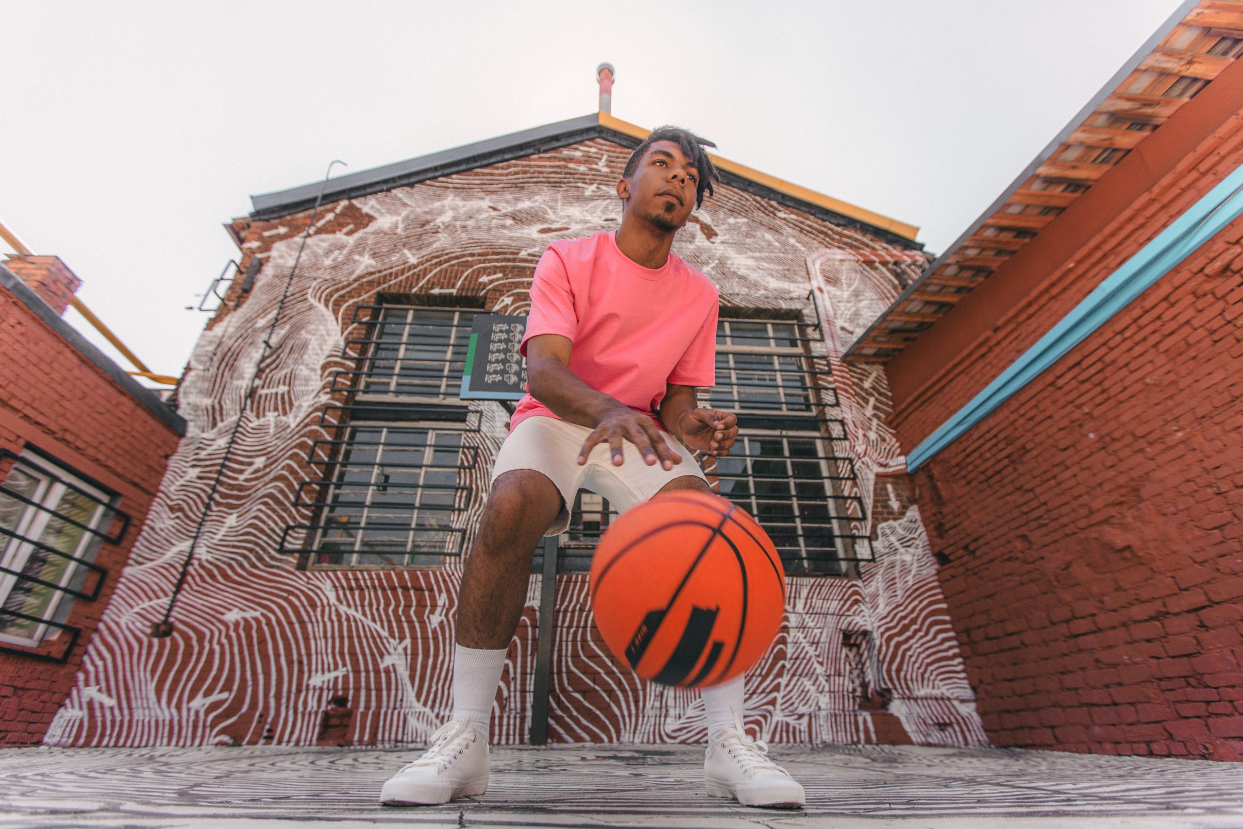 man playing basketball to get rid of man breast in a month