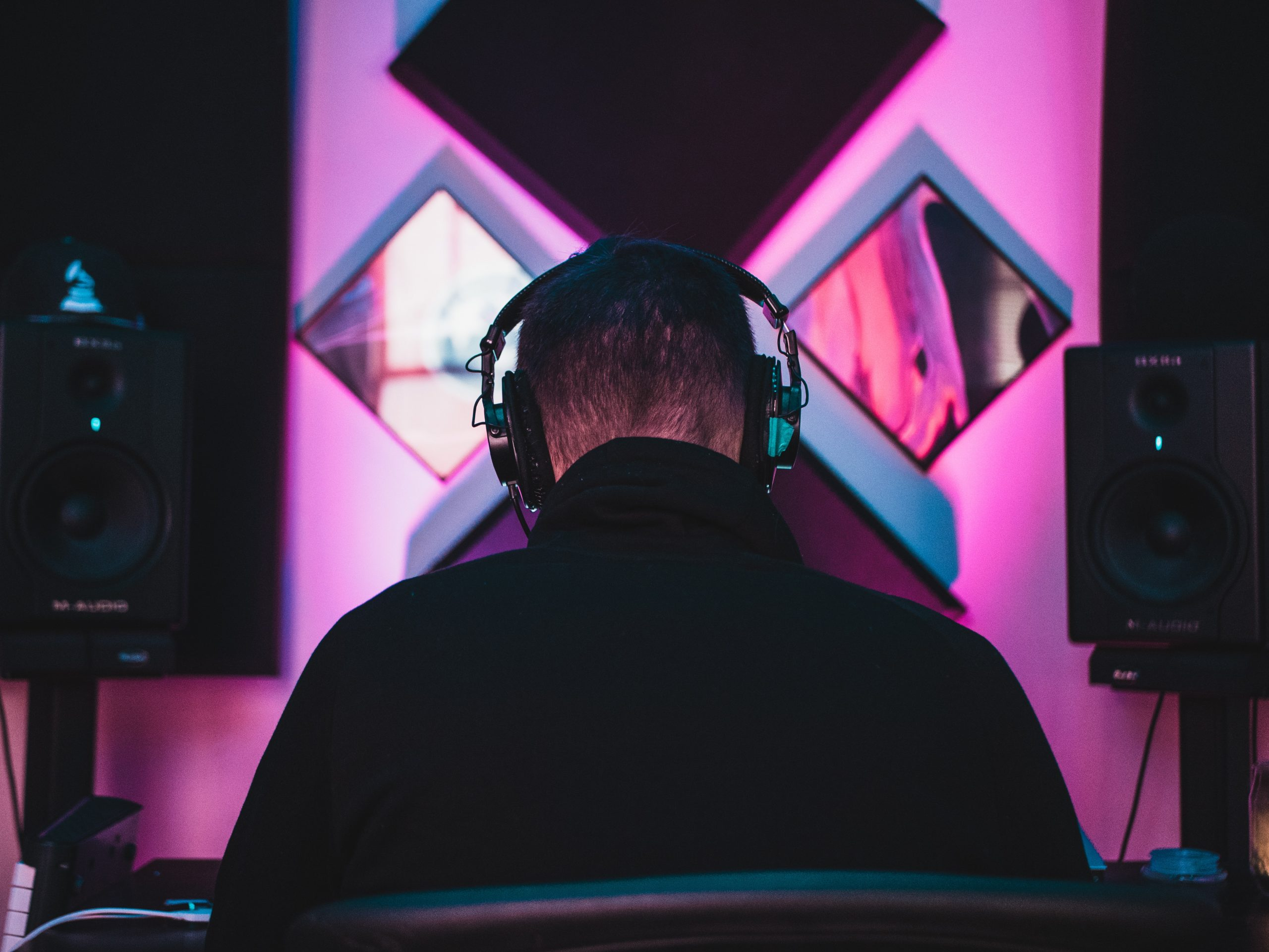 person wearing black headphones trying how to become a voice actor for video games