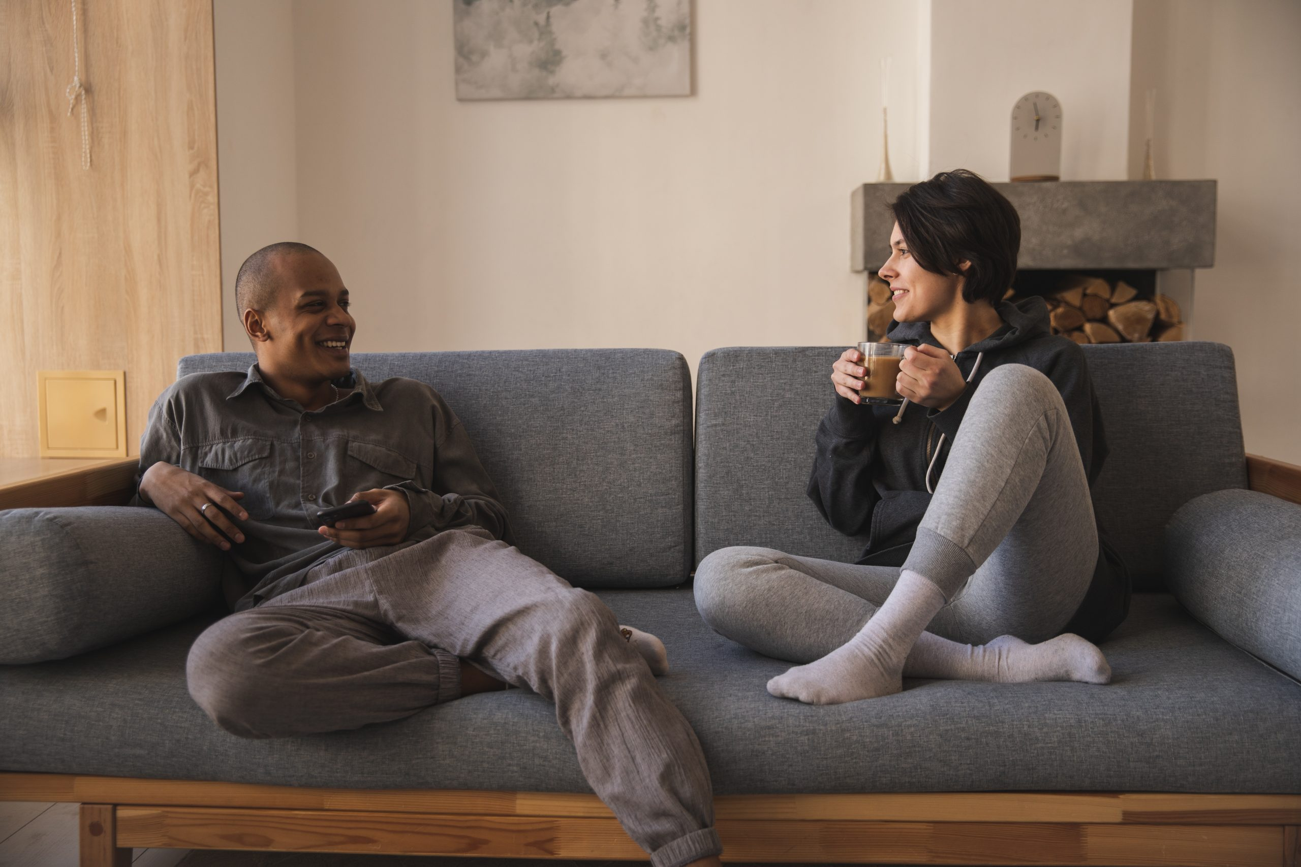 couple talking as they sit on a couch