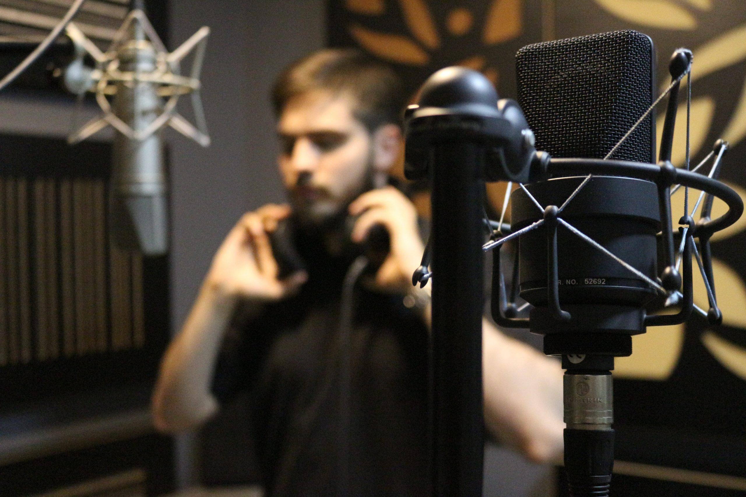 man in a recording studio to show how to become a voice actor for cartoons